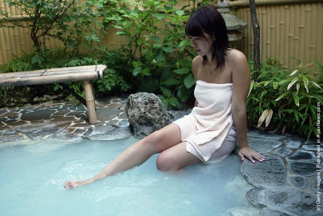 Japanese girl takes a bath