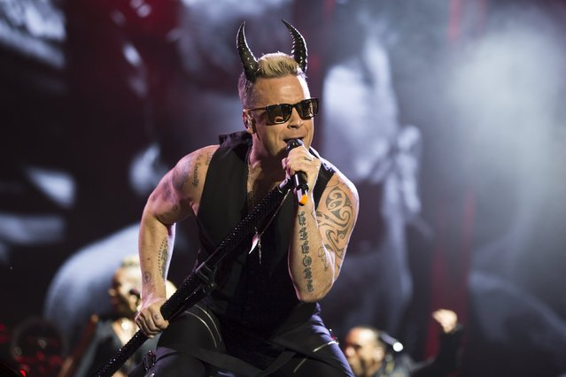 British singer Robbie Williams performs during a concert in Tel Aviv May 2, 2015. (Photo by Amir Cohen/Reuters)