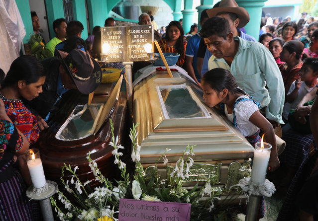 Town residents attend a wake for two boys who were kidnapped and killed on February 14, 2017 in San Juan Sacatepequez, Guatemala. More than 2,000 people walked in a funeral procession for Carlos Daniel Xiqin, 10, and Oscar Armando Top Cotzajay, 11,  who were reported abducted walking to school Friday morning. Residents found the boys stuffed in sacks over the weekend, with the boys' throats slashed and hands and feet bound. Neighbors reported a ransom demand was made. Such crimes have driven emigration from Guatemala to the United States, as families seek refuge from the violence. (Photo by John Moore/Getty Images)