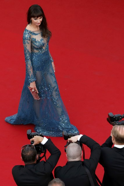 """Actress Frederique Bel poses on the red carpet as she arrives for the opening ceremony and the screening of the film """"La tete haute"""" out of competition during the 68th Cannes Film Festival in Cannes, southern France, May 13, 2015. (Photo by Benoit Tessier/Reuters)"""