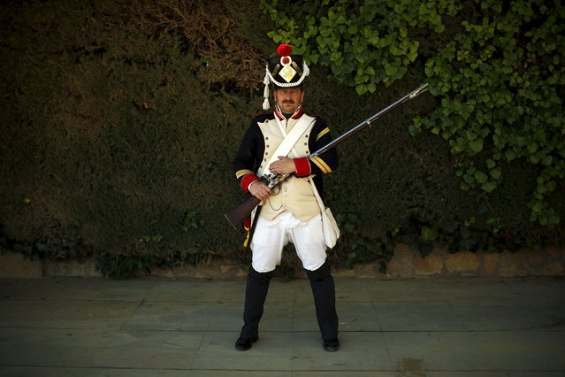 "Lisardo Lopez, 49, dressed in early nineteenth century French army uniform poses for a photo as he participates in the third edition of ""Ronda Romantica"" (Romantic Ronda) in Ronda, southern Spain, May 16, 2015. (Photo by Jon Nazca/Reuters)"