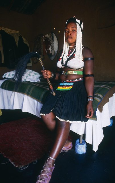 Pictured here is p*ssy, 18, who has been a Sangoma since the age of 11 and lives in Alexandra, one of the Johanesburg townships. (Photo by Patrick Durand/Sygma via Getty Images)