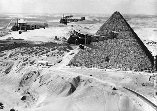1936: Vickers Valentias bomber-transporters flying over the Pyramids in the Egyptian desert