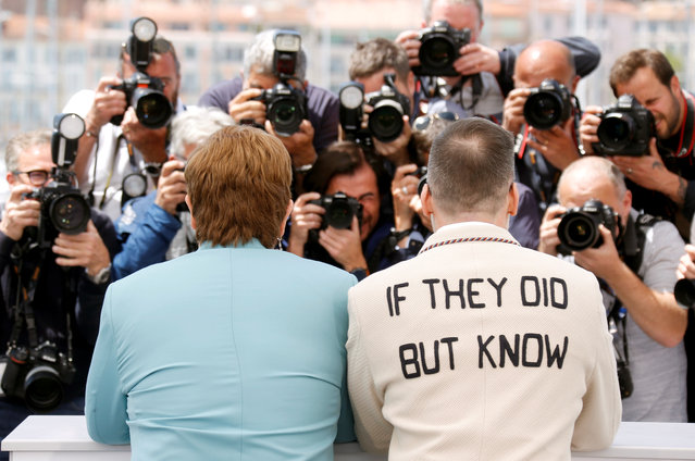 """British singer-songwriter Elton John (L) and his husband Canadian filmmaker David Furnish pose during a photocall for the film """"Rocketman"""" at the 72nd edition of the Cannes Film Festival in Cannes, southern France, on May 16, 2019. (Photo by Regis Duvignau/Reuters)"""