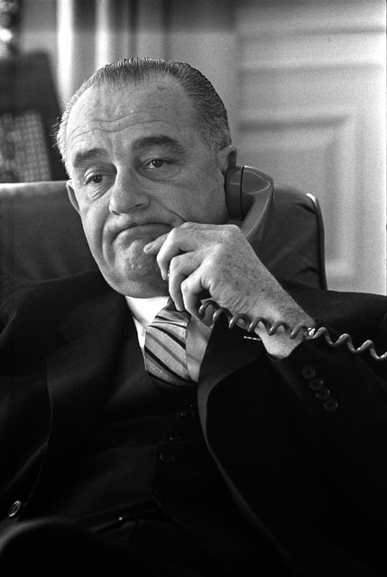 President Lyndon Johnson talks on the telephone from the Oval Office in 1964. Lyndon Baines Johnson was the 36th U.S. Presdident serving from 1963 – 1969. (Photo by Yoichi r. Okamoto/AP Photo/via LBJ Library)
