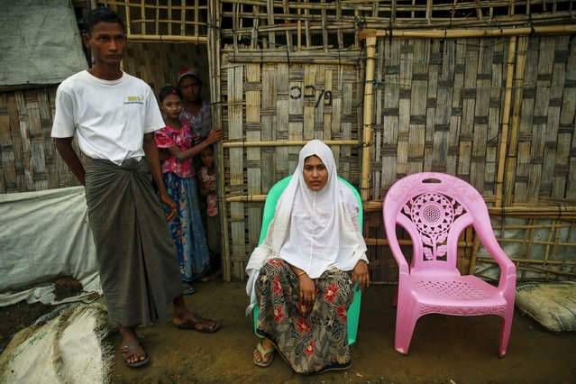 Marmot Rar Sein (L) and Be Be Asha, 20, who arrived back from a ship, are seen at a refugee camp outside Sittwe, Myanmar May 19, 2015. Scores of Myanmar's minority Rohingya Muslims are paying off people smugglers and returning to the squalid camps they used to live in after being held for months on overcrowded ships that were to take them to Thailand but did not move far from shore. (Photo by Soe Zeya Tun/Reuters)