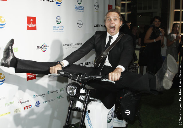 Ralf Bauer poses ona electro bike at the Clean Tech Media Award 2011 at Curio house