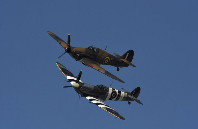 "British Hurricane (top) and Spitfire planes from World War II perform a fly-past as over Ramsgate harbour in south east England, May 21 , 2015. Over fifty ""Little Ships"", used in action in 1940, sailed to Dunkirk in northern France to mark the seventy fifth anniversary of Operation Dynamo in World War II when a mass evacuation took place of Allied troops as German forces advanced through France. (Photo by Toby Melville/Reuters)"
