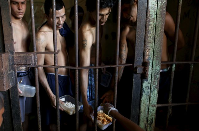 Inmates line up for food provided by the prison in Pavilion No.2 in La Joya prison on the outskirts of Panama City, Panama January 27, 2016. (Photo by Carlos Jasso/Reuters)