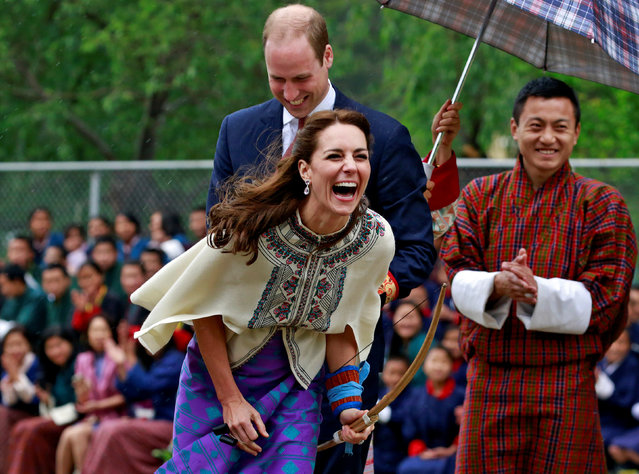 Britain's Catherine, Duchess of Cambridge reacts after shooting an arrow at Changlimithang Archery Ground in Thimphu, Bhutan, April 14, 2016. (Photo by Cathal McNaughton/Reuters)
