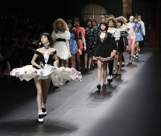 Models perfom a creation of the Sretsis by Thai fashion designer Pim Sukhahuta during the opening day of the Tokyo Collection for autumn-winter 2014-15 at the Shibuya Hikarie in Shibuya Ward, Tokyo on March 17, 2014. (Photo by The Yomiuri Shimbun via AP Images)
