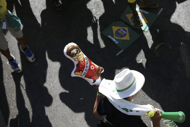 "Brazilians demonstrate for the impeachment of President Dilma Rousseff with a doll of Rouseff that reads, ""Mother of the Petroleum scandal"", as the Lower House of Congress voted in Brasilia, Brazil April 17, 2016. (Photo by Adriano Machado/Reuters)"
