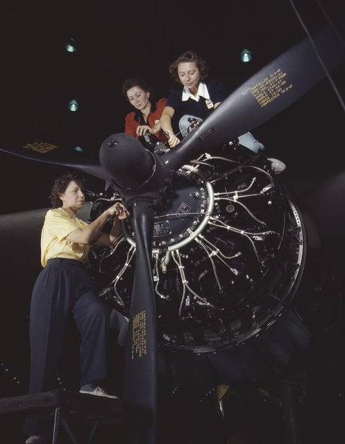 The careful hands of women are trained in precise aircraft engine installation duties at Douglas Aircraft Company, Long Beach, California, 1942. (Photo by Alfred T. Palmer/Buyenlarge/Getty Images)
