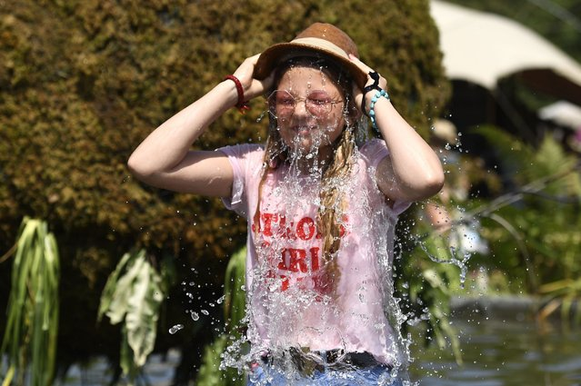 14 year old festival-goer Flower Sykes from Cornwall tips a hat filled with water over her head to cool down, during day four of Glastonbury Festival at Worthy Farm, Pilton on June 29, 2019 in Glastonbury, England. Glastonbury is the largest greenfield festival in the world, and is attended by around 175,000 people. (Photo by Leon Neal/Getty Images)
