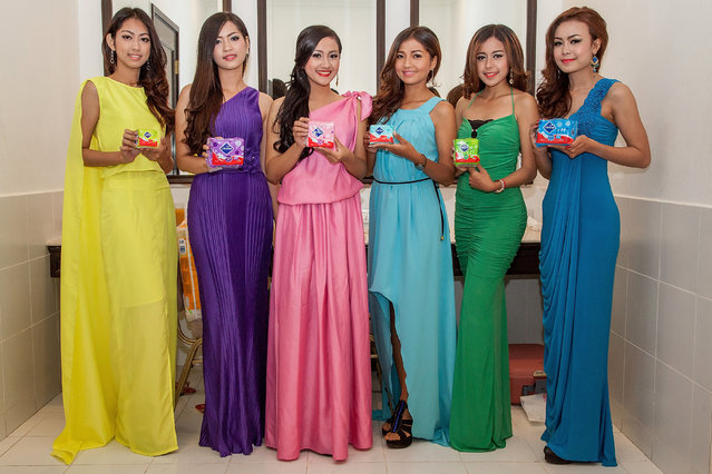 Professional models from the Sun Model Agency pose backstage for a photo ahead of the presentation of a new product being marketed in Cambodia at the Sofitel Hotel on March 30, 2014 in Phnom Penh, Cambodia. (Photo by Omar Havana/Getty Images)