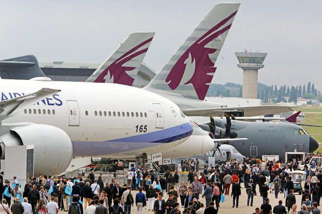Visitors crowd the alleys of the Paris Air Show in Le Bourget, north of Paris, Thursday June 18, 2015. Some 300,000 aviation professionals and spectators are expected at this week's Paris Air Show, coming from around the world to make business deals and see dramatic displays of aeronautic prowess and the latest air and space technology. (AP Photo/Remy de la Mauviniere)