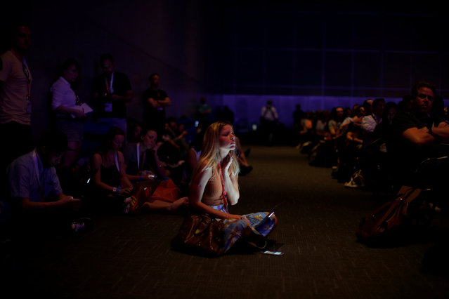 Attendees listen as mountain climber Cory Richards delivers the day's keynote address at the South by Southwest (SXSW) Music Film Interactive Festival 2017 in Austin, Texas, U.S., March 10, 2017. (Photo by Brian Snyder/Reuters)