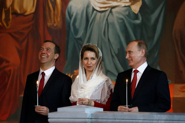 Russian President Vladimir Putin (R), Prime Minister Dmitry Medvedev and his wife Svetlana, attend an Orthodox Easter service in the Christ the Saviour Cathedral in Moscow, Russia, May 1, 2016. (Photo by Sergei Karpukhin/Reuters)