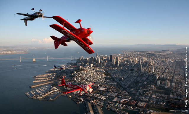 Planes for Team Oracle perform over downtown San Francisco during a practice session for San Francisco Fleet Week