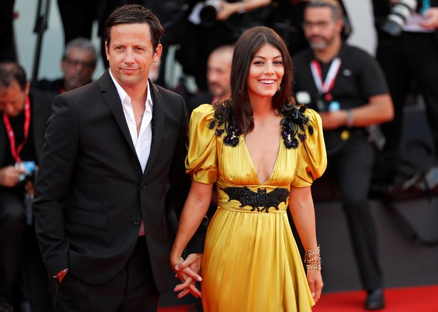 "Actors Ross McCall and Alessandra Mastronardi arrive during the screening of the film ""Marriage Story"" during the 76th Venice Film Festival at Sala Grande on August 29, 2019 in Venice, Italy. (Photo by Yara Nardi/Reuters)"