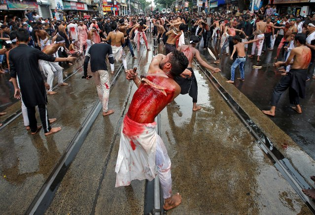 Shi'ite Muslim mourners flagellate themselves during a Muharram procession to mark Ashura in Kolkata, India, September 10, 2019. (Photo by Rupak De Chowdhuri/Reuters)