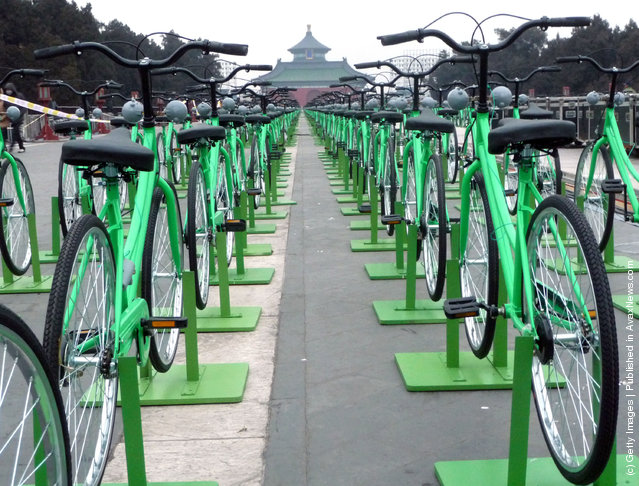 Hundreds of green bicycles are prepared as 960 of them await riders for the new year gala at the Temple of Heaven Park