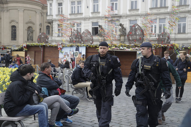 Policemen patrol the Old Town Square downtown Prague, Czech Republic, Wednesday, April 12, 2017. Czech authorities are boosting security measures across the country over Easter and Passover holidays following recent terror attacks in Europe. (Photo by Petr David Josek/AP Photo)