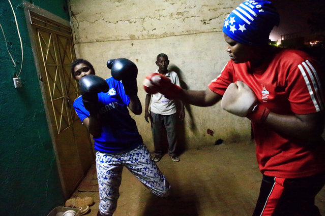 Sahar Mohamed Al Dooma (R), 26, challenges Saraa Mutawkil, 18, during boxing practice at Al Rabie club in Omdurman May 10, 2016. (Photo by Mohamed Nureldin Abdallah/Reuters)