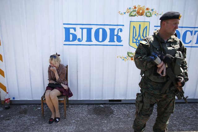 A woman cries after her partner is detained by Ukrainian security forces for being aggressive at an army checkpoint, on May 11, 2014. (Photo by Marko Djurica/Reuters)