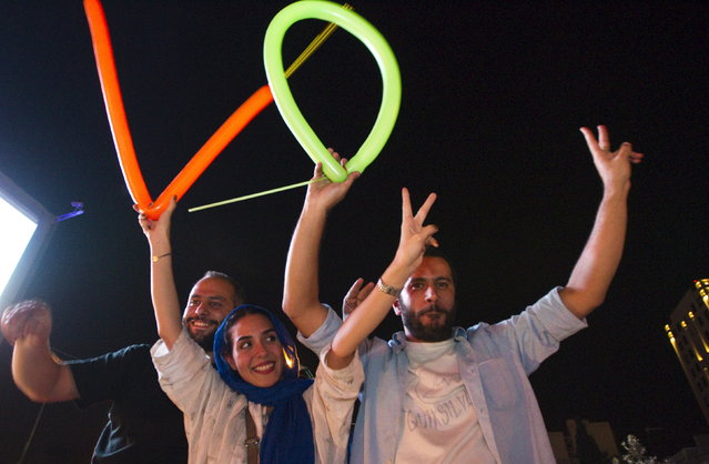 Iranians celebrate in the streets following a nuclear deal with major powers, in Tehran July 14, 2015. (Photo by Reuters/TIMA)