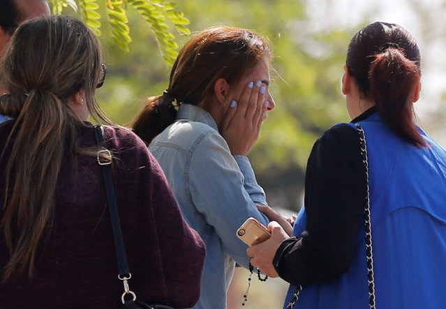 Unidentified relatives and friends of passengers who were flying in an EgyptAir plane that vanished from radar en route from Paris to Cairo react as they wait outside the Egyptair in-flight service building where relatives are being held at Cairo International Airport, Egypt May 19, 2016. (Photo by Amr Abdallah Dalsh/Reuters)