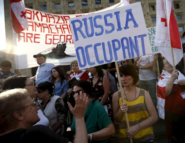 Protesters attend a rally against Russia's policy towards Georgia in Tbilisi, Georgia, July 18, 2015. Georgia accused Russia on Monday of violating its sovereignty by placing border markers on the edge of the South Ossetia region, leaving part of an international oil pipeline in territory under Russian control. (Photo by David Mdzinarishvili/Reuters)