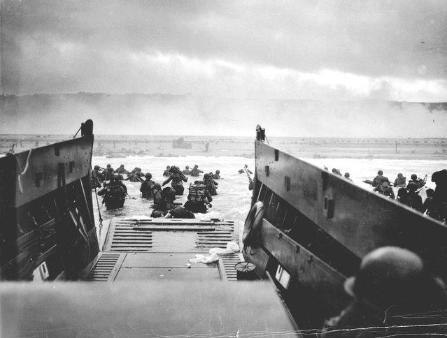 U.S. troops wade ashore from a Coast Guard landing craft at Omaha Beach during the Normandy D-Day landings near Vierville sur Mer, France, June 6, 1944. REUTERS/Robert F. Sargent/US National Archives