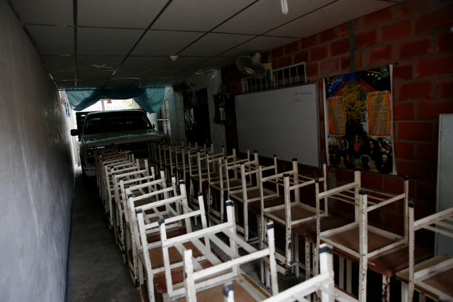 Desks are seen at an improvised classroom in a garage of a house, which is part of state school Monsenor Marco Tulio Ramirez Roa, in La Fria, Venezuela, June 1, 2016. (Photo by Carlos Garcia Rawlins/Reuters)