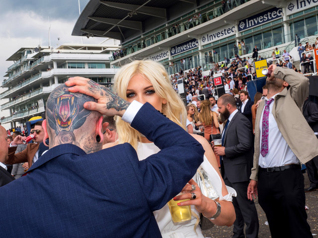 Jethro and Kitty from Stratford on Ladies' Day at Epsom, England on June 2, 2017. Ladies' Day is traditionally held on the first Friday of June, a multitude of ladies and gents head to Epsom Downs Racecourse to experience a day full of high octane racing, music, glamour and fashion. (Photo by Peter Dench/Getty Images Reportage)