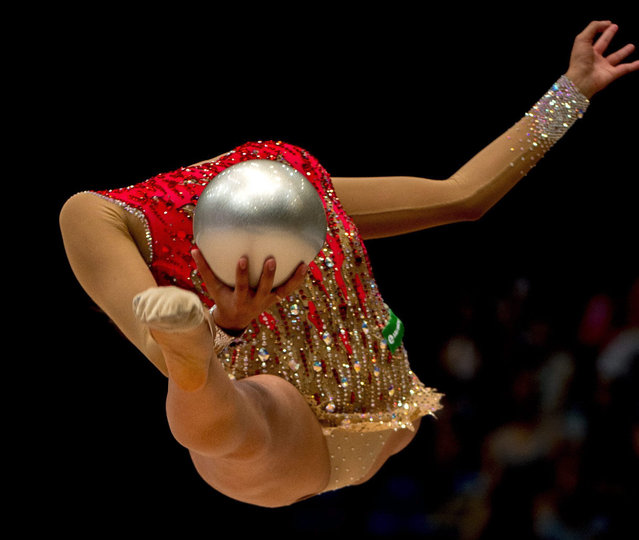 Margarita Mamun of Russia performs the ball exercise in the final of the individual competition of the 4th Hungarian Rhythmic Gymnastics World Cup tournament in Syma Event and Congress in Budapest, Hungary, 09 August 2015. Mamun placed second in the ball discipline. (Photo by Tibor Illyes/EPA)