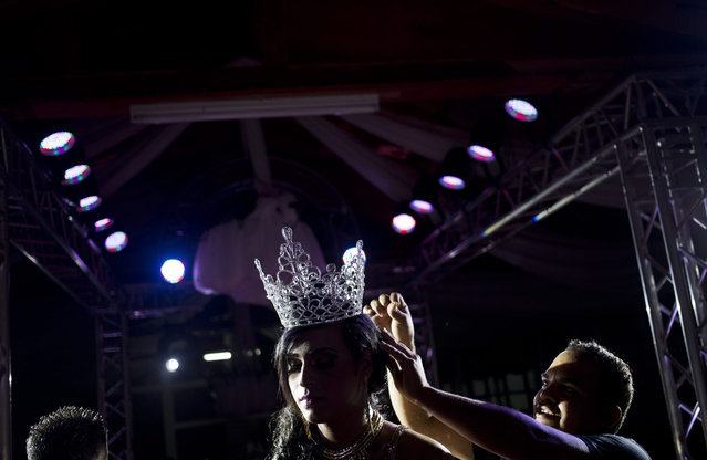 Gabriel Blandon, 25, is crowned Miss Gay Nicaragua in Matagalpa, Nicaragua, Saturday, August 8, 2015. Blandon says that he is rejected by his family and that he participated in the pageant without any family to accompany him. (Photo by Esteban Felix/AP Photo)