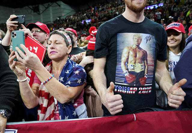 Attendees wear merchandise in support of U.S. President Donald Trump during a campaign rally at the University of Wisconsin-Milwaukee, in Milwaukee, Wisconsin, U.S., January 14, 2020. (Photo by Kevin Lamarque/Reuters)