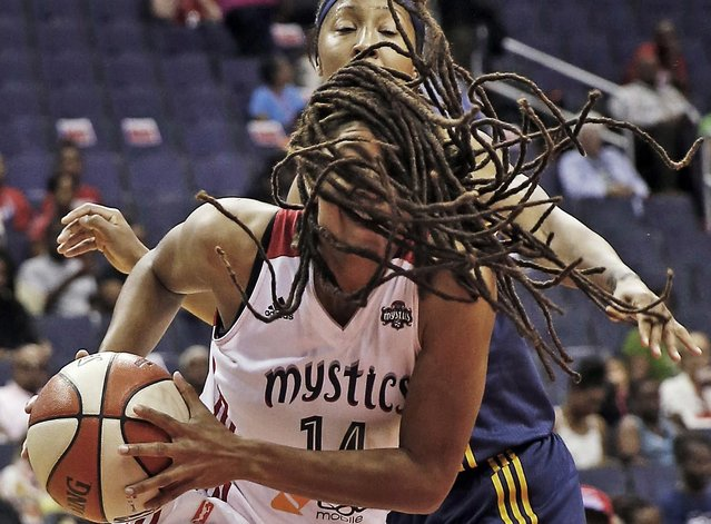 Washington Mystics guard Tierra Ruffin-Pratt, front, drives to the basket past Indiana Fever guard Briann January during the first half of a WNBA basketball game, Tuesday, August 11, 2015, in Washington. (Photo by Alex Brandon/AP Photo)