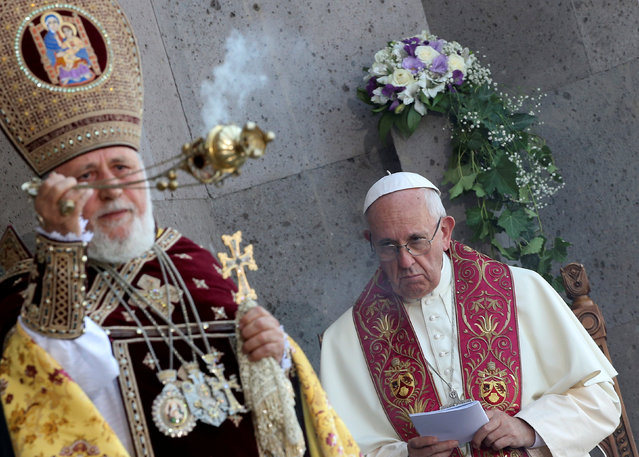 Pope Francis (R) looks on as Catholicos of All Armenians Karekin II (L) ceiebrates the Divine Liturgy at the Armenian Cathedral in Etchmiadzin, Armenia, June 26, 2016. (Photo by Alessandro Bianchi/Reuters)