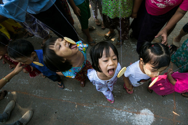 Children play a game as Myanmar celebrates its 72nd Independence Day in Yangon on January 4, 2020. The country is celebrating the 72nd anniversary of its declaration of independence from British colonial rule. (Photo by Sai Aung Main/AFP Photo)
