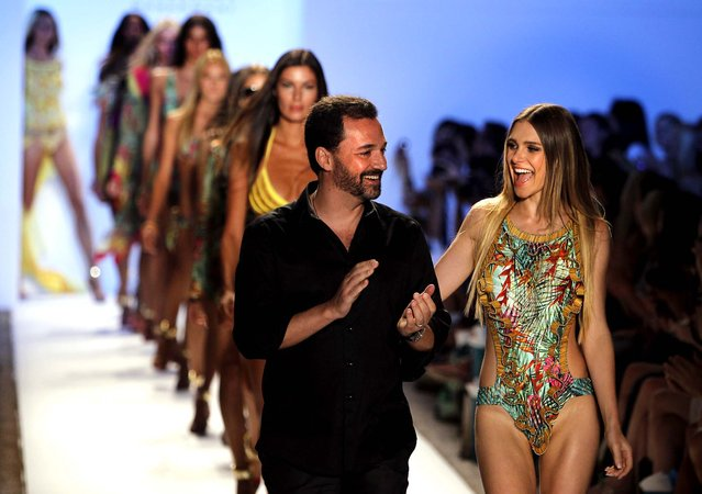 Cia. Maritima designer Benny Rosset walks on the runway with models wearing his collection of swimwear. (Lynne Sladky/Associated Press)