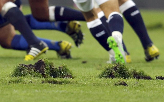 Clumps of turf are seen on the pitch as France plays England in their rugby union match at the Stade de France stadium in Saint-Denis, near Paris, France, August 22, 2015. (Photo by Regis Duvignau/Reuters)