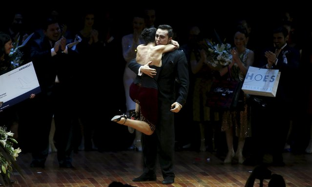 Jonathan Saavedra (R) and Clarisa Aragon from Argentina, who are representing the Argentine city of Cordoba, embrace after winning the Tango World Championship in Salon style, in Buenos Aires August 26, 2015. (Photo by Marcos Brindicci/Reuters)