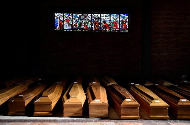Coffins of people who have died from coronavirus disease (COVID-19) are seen in the church of the Serravalle Scrivia cemetery, which like many places in northern Italy is struggling to cope with the number of deaths from the virus that is growing every day, in Alessandria, Italy, March 23, 2020. (Photo by Flavio Lo Scalzo/Reuters)