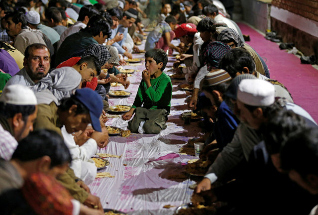 Afghan Muslims eat their Iftar meal at a mosque during the holy month of Ramadan in Kabul, Afghanistan June 16, 2016. (Photo by Omar Sobhani/Reuters)