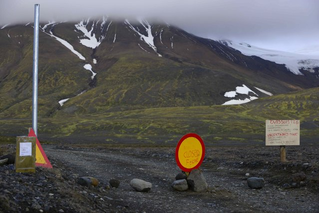Warning signs block the road to Bardarbunga volcano, about 12.5 miles away, in the northwest region of the Vatnajokull glacier in Iceland on August 17, 2014, where intense seismic activity and ongoing magma movement have been reported. (Photo by Sigtryggur Johannsson/Reuters)