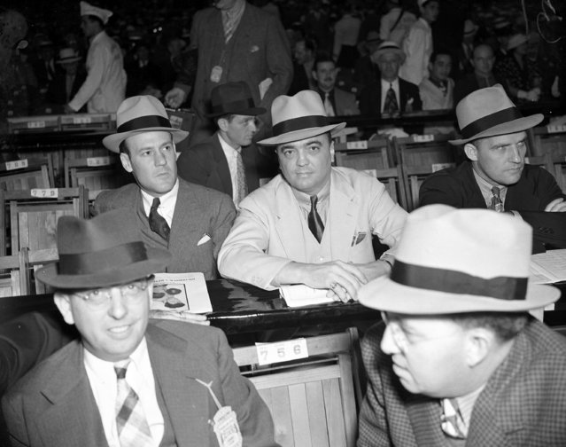 Director of the Federal Bureau of Investigation, J. Edgar Hoover, is seen with his bodyguards in Washington on June 28, 1937. (Photo by AP Photo)