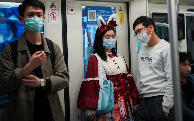 Passengers wear protective masks while riding a subway train on April 21, 2020 in Shanghai, China. Health authorities of China said the country has passed the peak of the COVID-19 epidemic on March 12. As of today, the Coronavirus (COVID-19) pandemic has spread to many countries across the world, claiming over 171,000 lives and infecting over 2.4 million people. (Photo by Yves Dean/Getty Images)