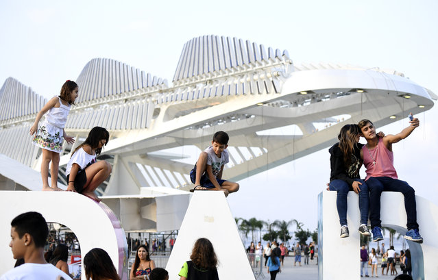 Visitors gather in the plaza outside the newly constructed  Museum of Tomorrow on August 2, 2016 in Rio De Janeiro, Brazil. (Photo by Jonathan Newton/The Washington Post)